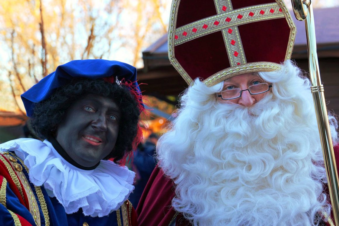 Two people in the Netherlands dressed up as Zwarte Piet and Sinterklaas