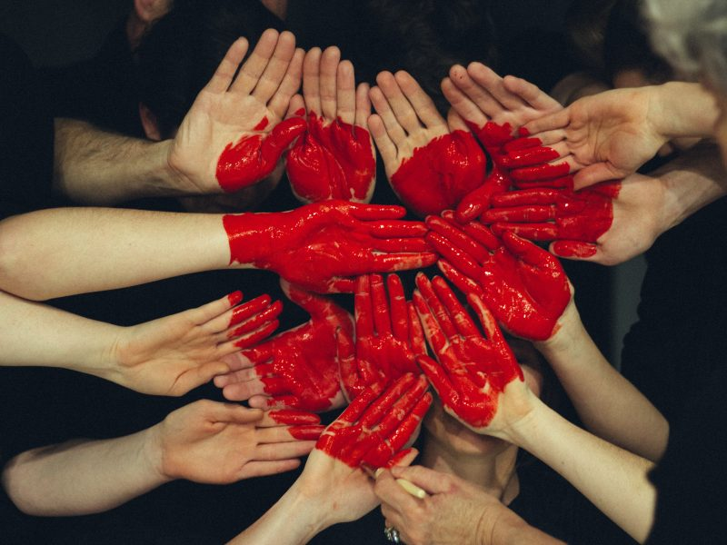 Hands forming a heart in solidarity