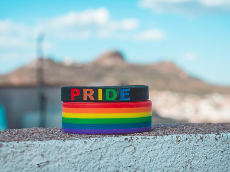Rainbow flag and pride armbands on a wall