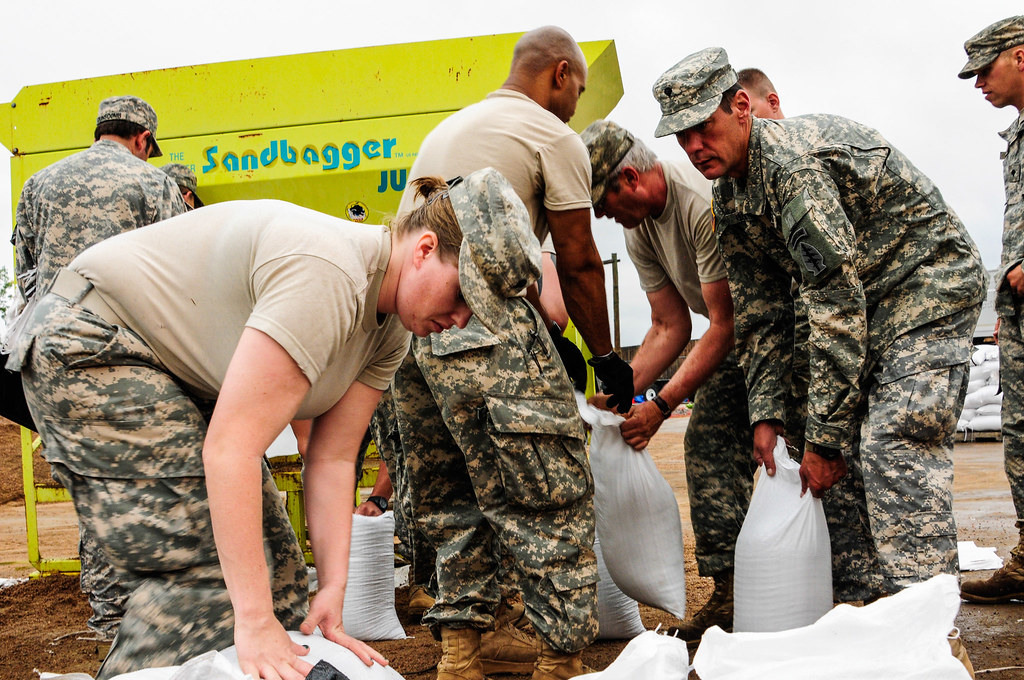Military personnel assisting with flood relief