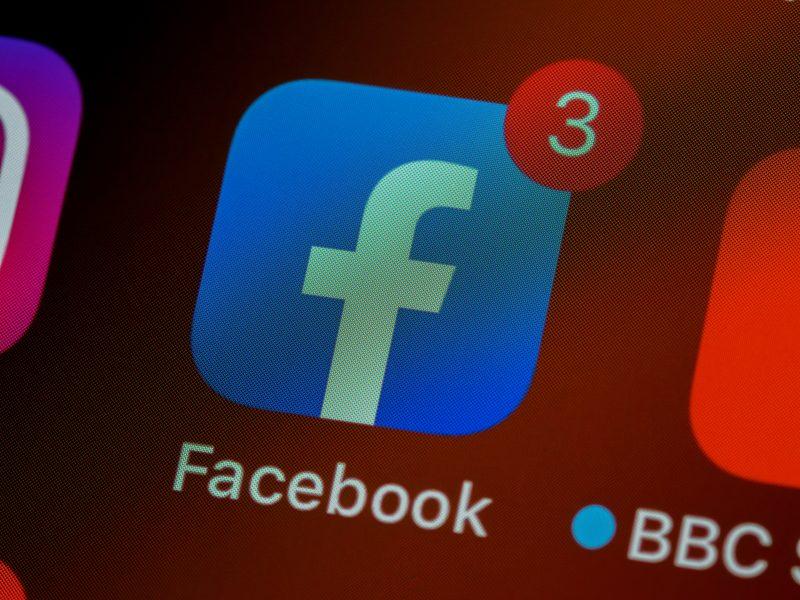 Facebook logo on a screen